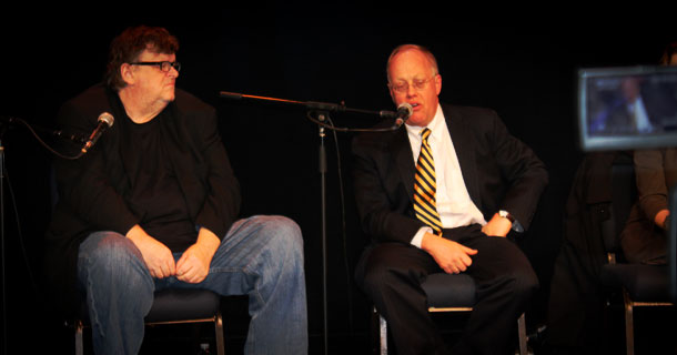 FOR THE PEOPLE: Documentary filmmaker Michael Moore (l) and Pulitzer Prize-winning former New York Times foreign correspondent Chris Hedges discussing the importance of defeating the Obama Administration's indefinite detention provision to the NDAA and its ramifications on American's civil liberties at a panel discussion organized by The Sparrow Project Feb. 6, 2013 in Manhattan.