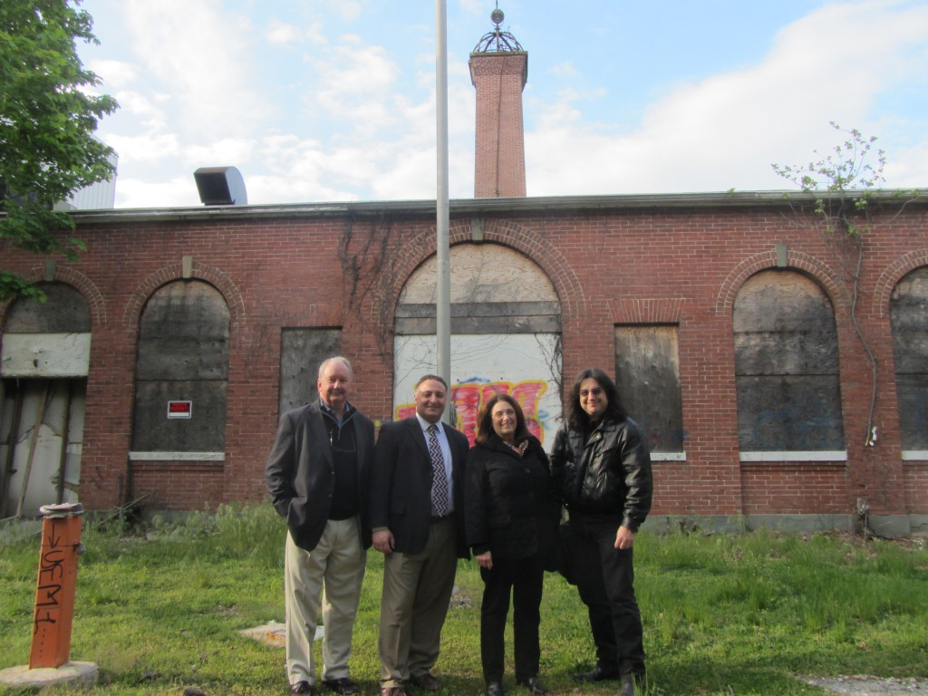 Supporters of the Tesla Science Center at Wardenclyffe in Shoreham Monday, May 13. Left to right: David Madigan, former Assemblyman Marc Alessi, Jane Alcorn, and filmmaker Joe Sikorski. (Photo credit: Spencer Rumsey/Long Island Press)