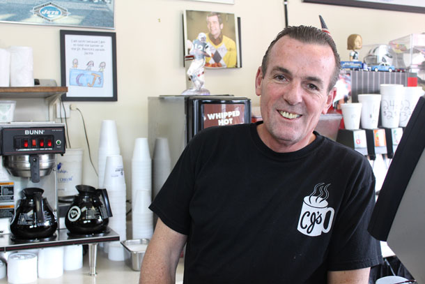 Chris Lawrence, owner of CJ's coffee shop, in Rockville Centre. (Rashed Mian/Long Island Press)