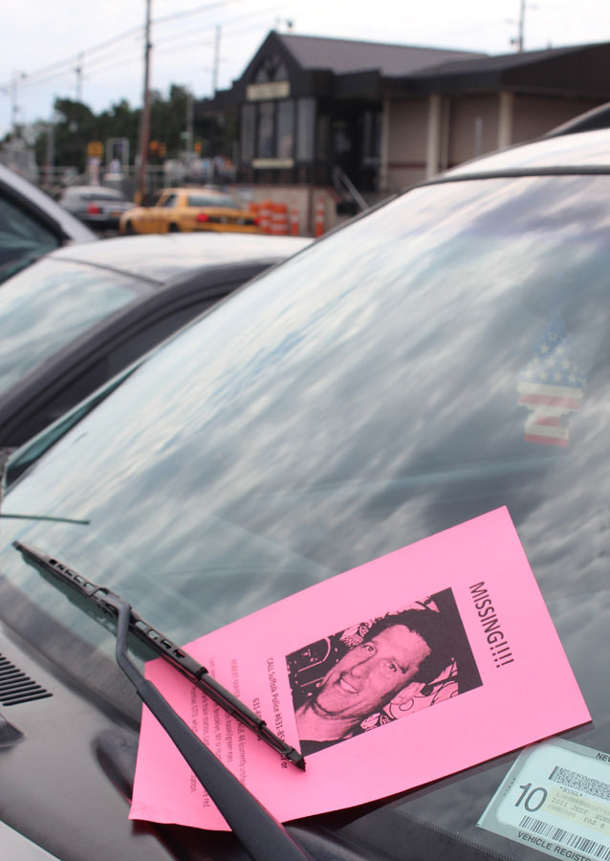 A missing person flyer tucked onto the windshield of a car at the Long Island Rail Road Deer Park Station, where his bright red 2004 Pontiac GTO was found. (Photo credit: Bob Savage)