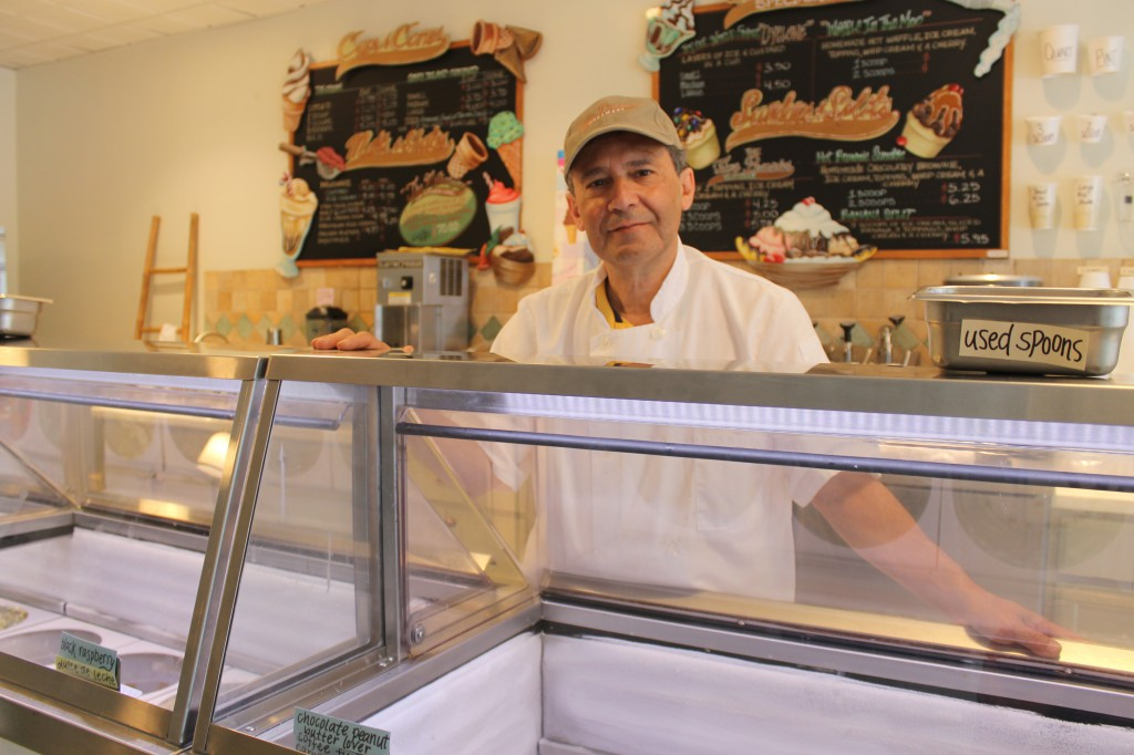 Dan Levine mixes up more than 100 flavors at Five Pennies in Rockville Centre, a cozy ice cream shop in the heart of the village's shopping district.  (Rashed Mian/Long Island Press)