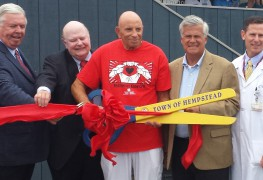 New York State Assemb. Harvey Weisenberg (D-Long Beach) cuts the ribbon for the new South Nassau Urgent Care Center at Long Beach along with hospital officials and lawmakers on Thursday, July 10, 2014.