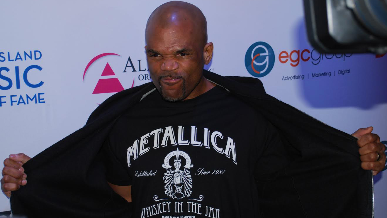 "Darryl McDaniels, ""DMC"" of hip-hop pioneers Run DMC, flashes his Metallica love on the red carpet of the Long Island Music Hall of Fame Induction Thursday, Oct. 23, 2014 at The Paramount in Huntington. (Christopher Twarowski / Long Island Press)"