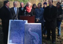 Suffolk County and Brookhaven Town officials joined legislators and environmentalists to mark a key purchase of sensitive land along the Carmans River.