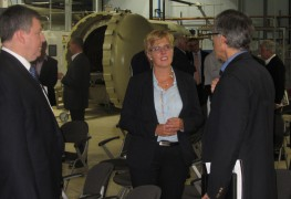 LM Wind Power's director Dorte Kamper, center, talks about Long Island's potential for offshore energy production at a trade delegation visit to the Composite Prototyping Center in Plainview.