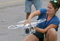 A journalist fixes a drone used to film the riots in Ferguson, Mo. on Aug. 17, 2014.
