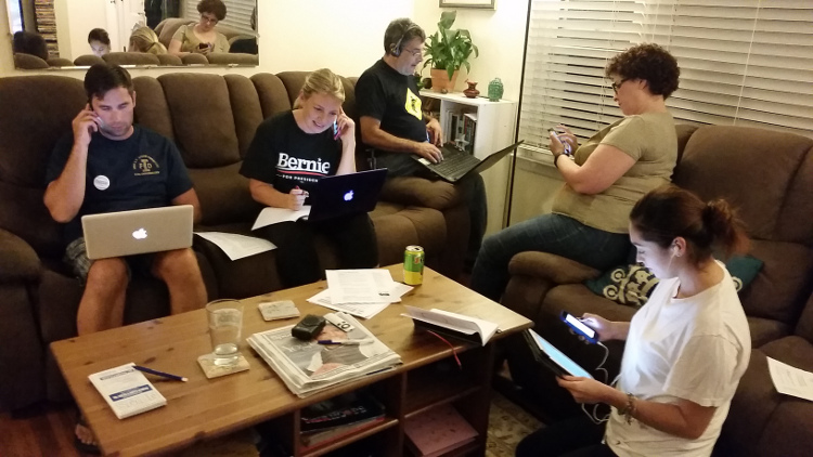 Long Island supporters of Vermont Senator Bernie Sanders in late September making phone calls to remind voters wishing to participate in next year's primaries to make sure they're registered by Oct. 9. Joe Tronolone (left) hosted the event,