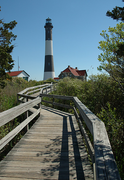 FIRE IN THE SKY: Some believe the Fire Island Lighthouse, which has aided the navigation of countless seafaring vessels for more than 150 years, to also be a beacon for wayward spirits. (Timothy Bolger / Long Island Press)
